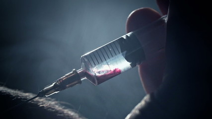 Junkie addict injects heroin or meth by syringe into a vein