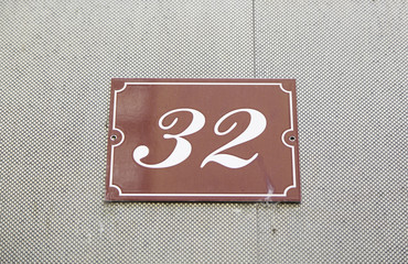 Number thirty-two on the wall of a house