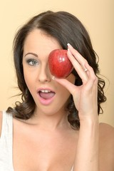 Beautiful Young Woman Holding a Single Fresh Ripe Apple