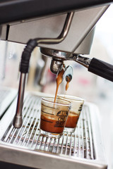 Espresso coffee machine, Coffee is pouring in a glass of coffee