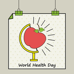 World Health Day concept with apple on globe stand.