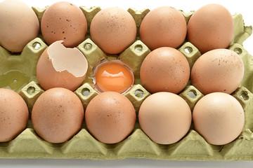 Broken Egg in Cardboard Close-up