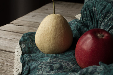 pear with apples on a brown background
