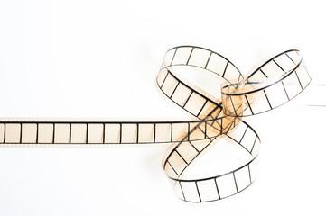 35mm movie filmstrip, film bow on white background