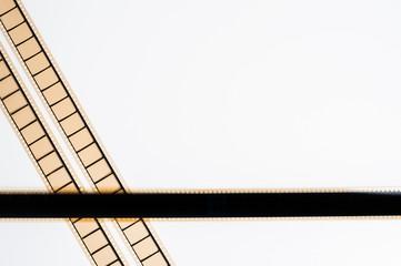 35 mm movie film stripes on white background