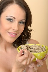Beautiful Young Woman Holding a Bowl of Breakfast Cereal