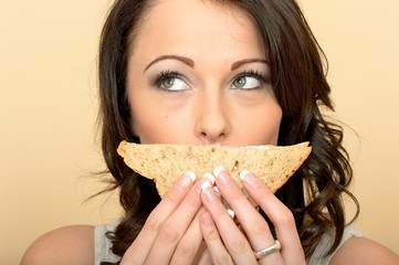 Attractive Beautiful Young Woman Holding a Brown Bread Prawn and