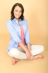 Young Attractive Woman Sitting Crossed Legged and Back Straight