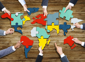 Business People World Map Puzzle Pieces Concept