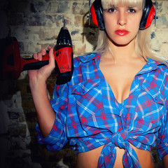 Sexy Girl holding a screwdriver