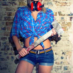 Sexy Girl holding a hammer