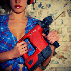 Sexy Girl holding a drill