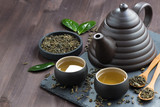 set for tea ceremony on a wooden table © cook_inspire