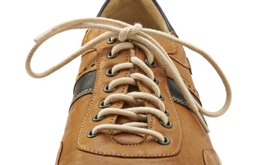 Shoelace in close up and brown shoe isolated on white