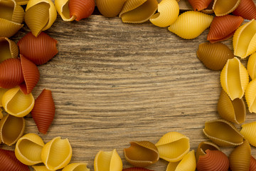 Cavatelli pasta on wooden table top view frame