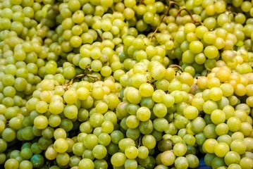 Bunches of green grapes for sale at farmers market.