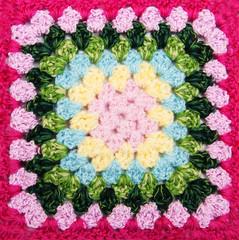 multicolored plaid square of crocheted