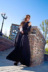 beautiful fashionable woman in the street