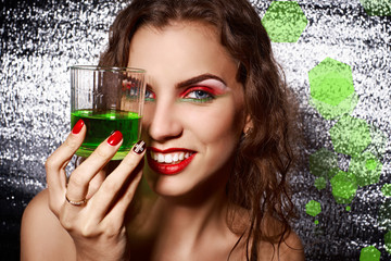 Sensual woman with Creative make-up and glass of alcohol, cockta