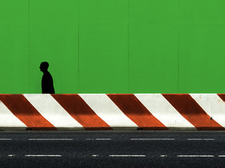 shape of a man walking in the street under construction