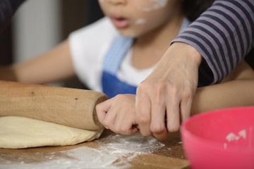 Mother Teaching Her Daughter Making Bread