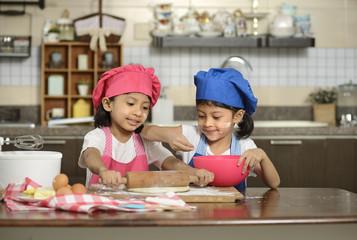 Two Little Girls Make Pizza