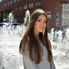 Outdoor portrait of attractive teen girl