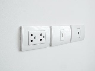 Close up of plug in a wall socket.