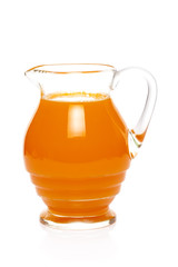 Orange juice in glass jug isolated on white