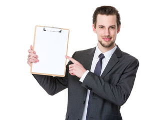 Confident businessman with clipboard