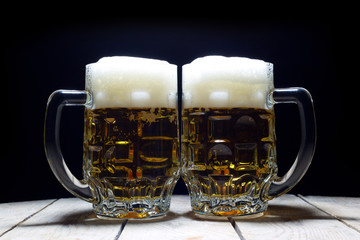 Two Mugs of Cold Beer Are the Best Way to Quench Thirst