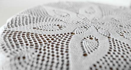 flower symmetrical pattern lace doily close to
