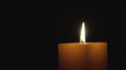 Flaming Orange Candle in the Dark