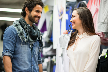 Couple shopping in a dress shop