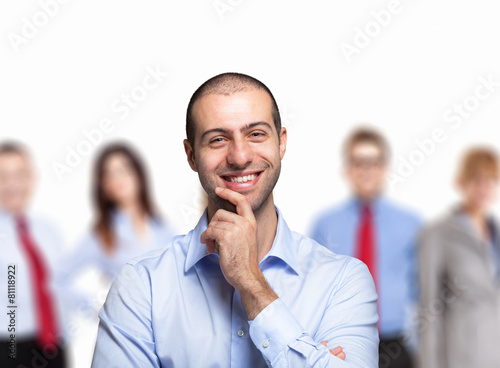 Nice smiling man in front of a group of people - 81118922