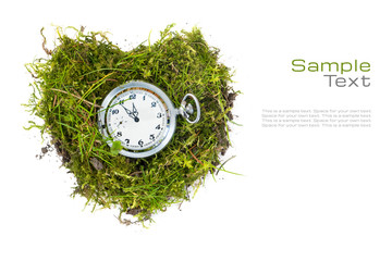 pocket watch in a heart of grass isolated on white for health ca