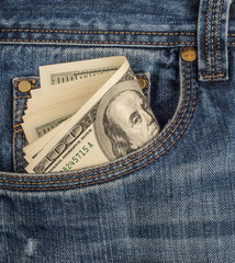 Cash in the front pocket of blue jeans closeup