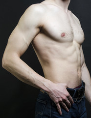 Naked male body sport on a black background