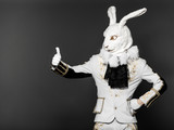 Bunny standing in white suit  having made  helpless gesture poster