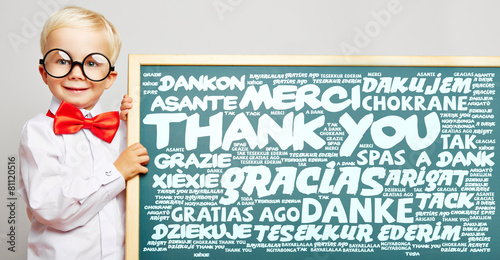 Leinwandbild Motiv Danke in vielen Sprachen auf einer Tafel