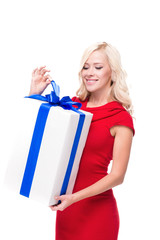 Smiling blonde woman with present isolated on white