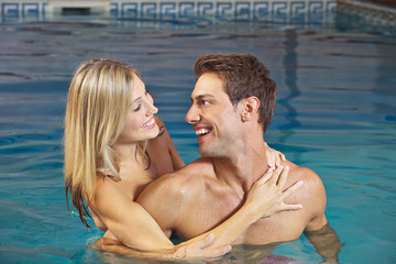 Laughing couple in swimming pool