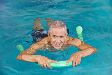 Man swimming in water of pool