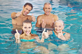 Group in water holding thumbs up