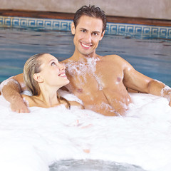 Couple taking foam bubble bath