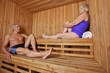 Senior people sitting sweating in sauna