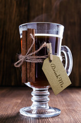 Hot coffee in a glass with cinnamon stick
