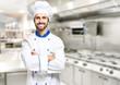 Leinwandbild Motiv Smiling chef in his kitchen