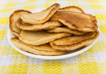 Plate with Russian pancakes on cloth