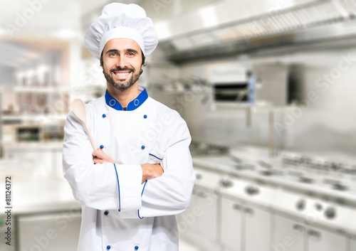 Smiling chef in his kitchen - 81124372